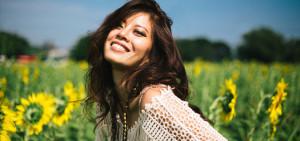 3 spiritual practices HappyWomanInASunflowerField-850x400